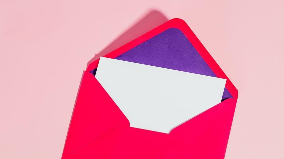 red-purple-envelope-white-paper